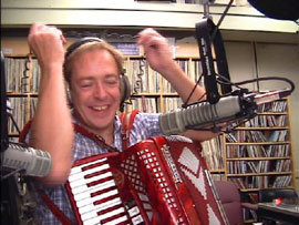 Gary Sredzienski plays accordion on air at WUNH radio